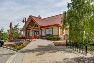 Photo 30: 105 Rocky Ridge Court NW in Calgary: Rocky Ridge Row/Townhouse for sale : MLS®# A1069587