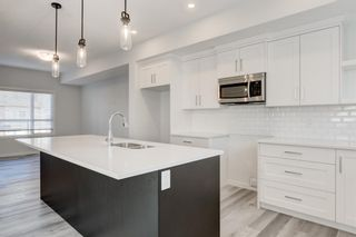Photo 12: 268 Harvest Hills Way NE in Calgary: Harvest Hills Row/Townhouse for sale : MLS®# A1069741