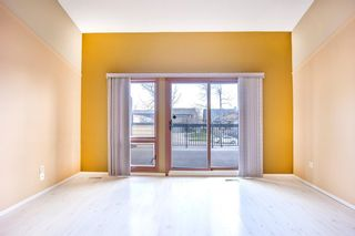 Photo 5: 7050 Edgemont Drive NW in Calgary: Edgemont Row/Townhouse for sale : MLS®# A1108400