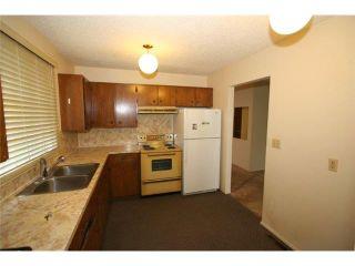 Photo 6: 7712 HUNTERVIEW Drive NW in CALGARY: Huntington Hills 4Plex for sale (Calgary)  : MLS®# C3630605