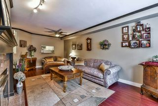 """Photo 4: 106 9865 140 Street in Surrey: Whalley Condo for sale in """"Fraser Court"""" (North Surrey)  : MLS®# R2137812"""