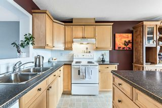 Photo 13: 6 Crystal Shores Cove: Okotoks Row/Townhouse for sale : MLS®# A1080376