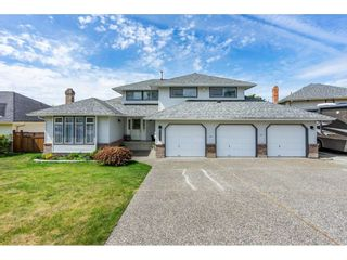 """Photo 1: 6495 180 Street in Surrey: Cloverdale BC House for sale in """"Orchard Ridge"""" (Cloverdale)  : MLS®# R2396953"""