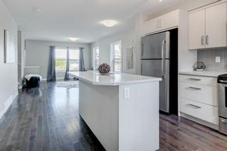 Photo 11: 205 1225 Kings Heights Way SE: Airdrie Row/Townhouse for sale : MLS®# A1122375