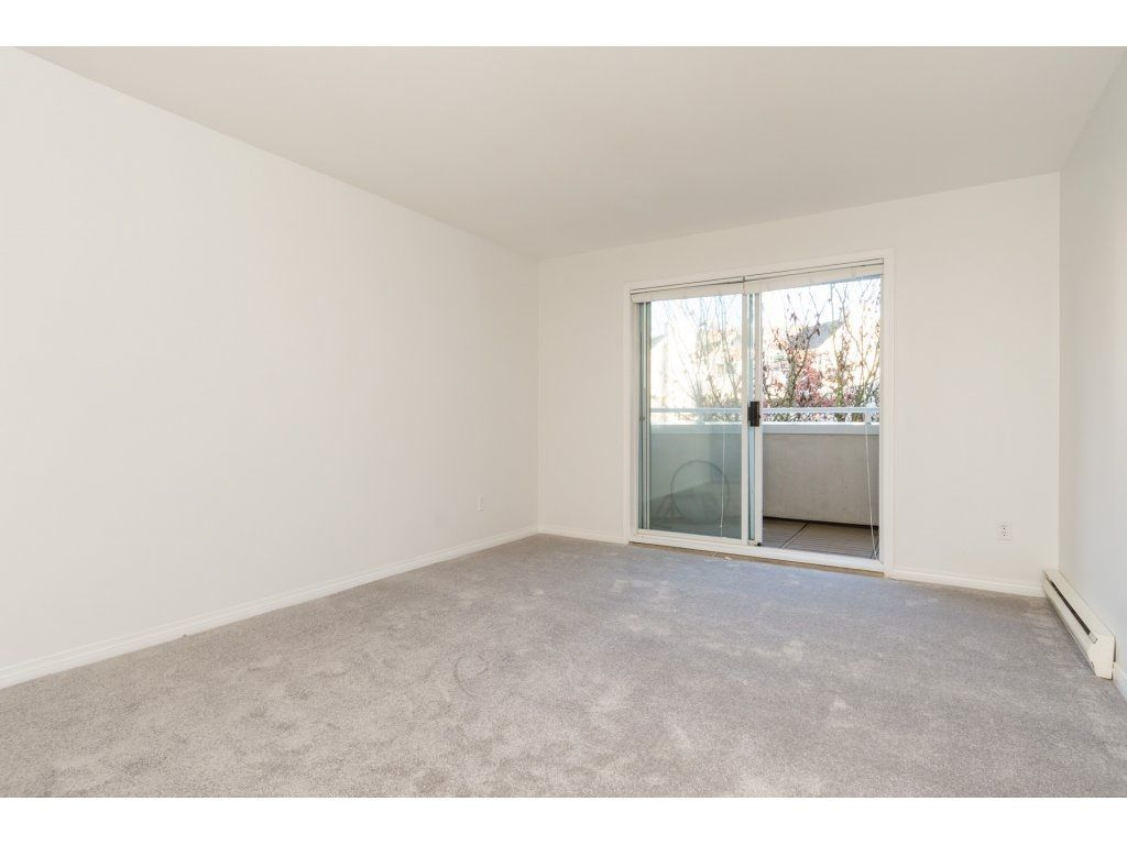 "Photo 13: Photos: 211 12633 72 Avenue in Surrey: West Newton Condo for sale in ""College Park"" : MLS®# R2226813"