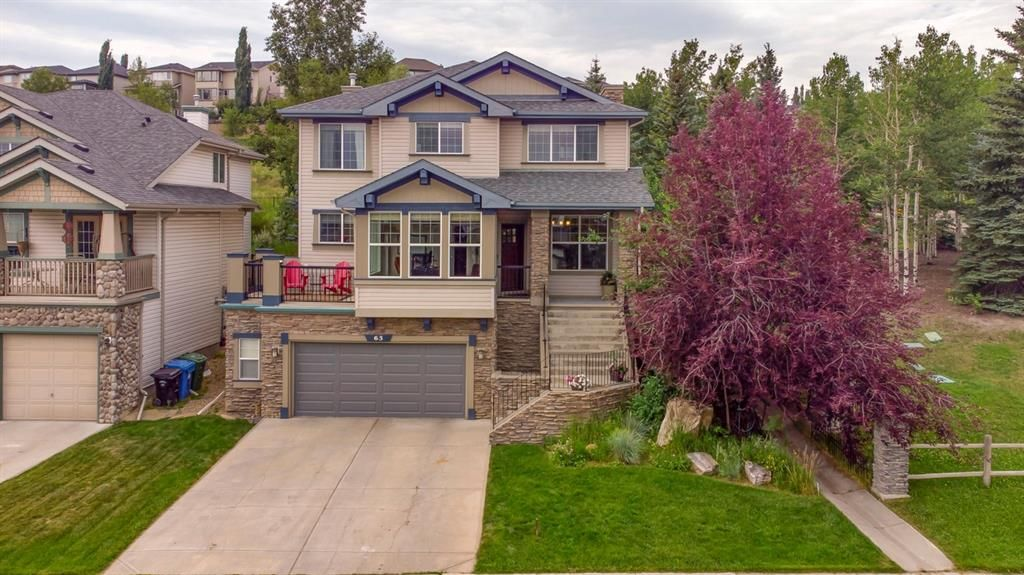 Main Photo: 63 Springbluff Boulevard SW in Calgary: Springbank Hill Detached for sale : MLS®# A1131940