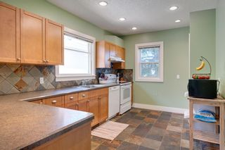 Photo 8: 3118 39 Street SW in Calgary: Glenbrook Detached for sale : MLS®# A1105435