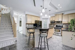 Photo 12: 163 Springbluff Heights SW in Calgary: Springbank Hill Detached for sale : MLS®# A1153228