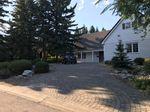 Main Photo: 268 Eagle Ridge Drive SW in Calgary: Eagle Ridge Detached for sale : MLS®# A1094505