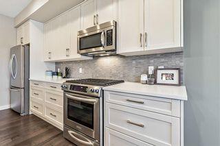 Photo 13: 2 CRANBROOK Villa SE in Calgary: Cranston Row/Townhouse for sale : MLS®# C4215391
