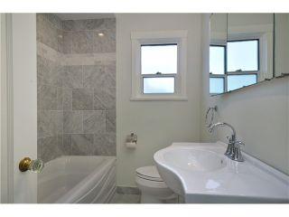 Photo 8: 4847 HENRY Street in Vancouver: Knight House for sale (Vancouver East)  : MLS®# V996847