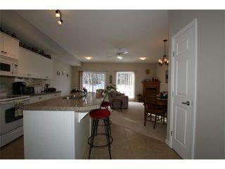 Photo 18: 155 CRAWFORD Drive: Cochrane House for sale : MLS®# C4092224