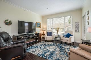 """Photo 5: 411 20281 53A Avenue in Langley: Langley City Condo for sale in """"Gibbons Layne"""" : MLS®# R2621680"""