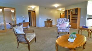 Photo 8: 407 7239 SIERRA MORENA Boulevard SW in Calgary: Signal Hill Apartment for sale : MLS®# C4303319