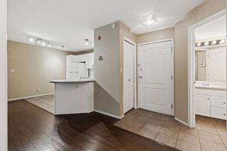Photo 5: 107 20 Sierra Morena Mews SW in Calgary: Signal Hill Apartment for sale : MLS®# A1136105