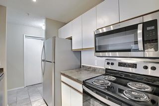 Photo 10: 207 33 Arbour Grove Close NW in Calgary: Arbour Lake Apartment for sale : MLS®# A1135288