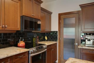 Photo 13: 97 Tuscany Glen Way NW in Calgary: Tuscany Detached for sale : MLS®# A1113696