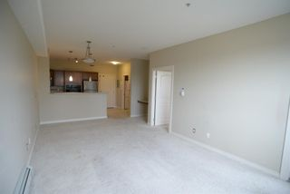 Photo 9: 204 26 VAL GARDENA View SW in Calgary: Springbank Hill Apartment for sale : MLS®# A1045498