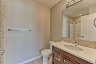 Photo 16: 539 Panatella Walk NW in Calgary: Panorama Hills Row/Townhouse for sale : MLS®# A1125854