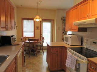 Photo 9: 24 Shannon Estates Terrace SW in Calgary: Shawnessy Row/Townhouse for sale : MLS®# A1102178