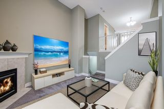 Photo 8: 312 BRIDLEWOOD Lane SW in Calgary: Bridlewood Row/Townhouse for sale : MLS®# A1046866