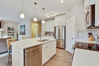 Photo 9: 207 Kinniburgh Road: Chestermere Semi Detached for sale : MLS®# A1057912
