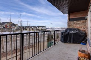 Photo 10: 2102 15 SUNSET Square: Cochrane Condo for sale : MLS®# C4172939