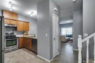 Photo 10: 204 720 Willowbrook Road NW: Airdrie Row/Townhouse for sale : MLS®# A1123024