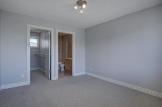 Photo 16: 76 Bridleridge Manor SW in Calgary: Bridlewood Row/Townhouse for sale : MLS®# A1106883