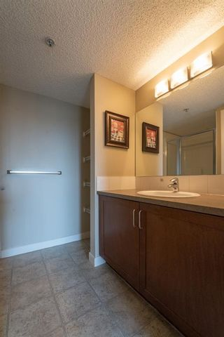 Photo 11: 210 156 Country Village Circle NE in Calgary: Country Hills Village Apartment for sale : MLS®# A1135703