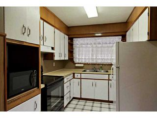 Photo 7: 85 KIRBY Place SW in Calgary: Kingsland Residential Detached Single Family for sale : MLS®# C3648875