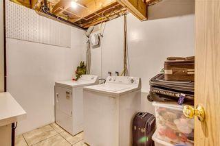 Photo 35: 111 ERIN RIDGE Road SE in Calgary: Erin Woods House for sale : MLS®# C4162823