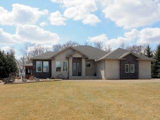 Photo 1: 695 Mclenaghen Drive in Portage la Prairie: House for sale : MLS®# 202109619