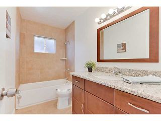 Photo 12: SERRA MESA House for sale : 5 bedrooms : 8830 Raejean Avenue in San Diego
