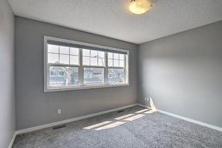 Photo 30: 566 River Heights Crescent: Cochrane Semi Detached for sale : MLS®# A1129968