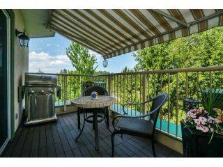 "Photo 2: 424 13880 70TH Avenue in Surrey: East Newton Condo for sale in ""CHELSEA GARDENS"" : MLS®# F1445932"