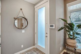 Photo 2: 1306 2 Street NE in Calgary: Crescent Heights Row/Townhouse for sale : MLS®# A1079019