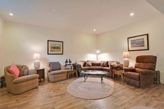Photo 13: 215 Sunset Square in Cochrane: Duplex for sale : MLS®# C4007845