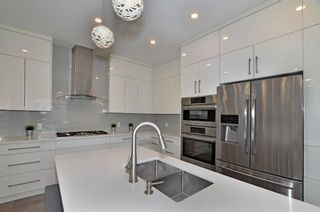 Photo 7: 154 21 Avenue NW in Calgary: Tuxedo Park Row/Townhouse for sale : MLS®# A1098746
