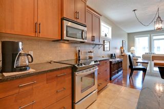 Photo 6: 215 Sunset Square in Cochrane: Duplex for sale : MLS®# C4007845