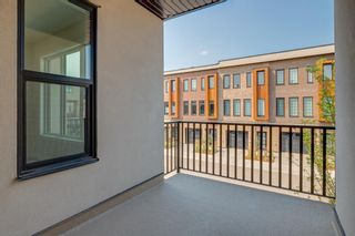 Photo 15: 231 81 Greenbriar Place NW in Calgary: Greenwood/Greenbriar Row/Townhouse for sale : MLS®# A1104462