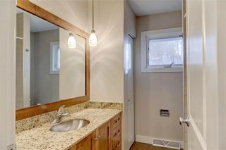 Photo 13: 611 WOODSWORTH Road SE in Calgary: Willow Park Detached for sale : MLS®# C4216444
