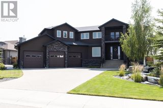 Photo 1: 220 Prairie Rose Place S in Lethbridge: House for sale : MLS®# A1137049
