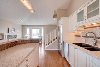 Photo 9: 52 100 Signature Way SW in Calgary: Signal Hill Semi Detached for sale : MLS®# A1100038