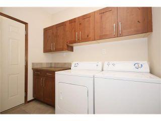 Photo 14: 103 WEST POINTE Court: Cochrane House for sale : MLS®# C4042878