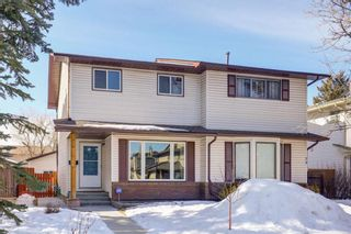 Photo 2: 77 Cedardale Crescent SW in Calgary: Cedarbrae Semi Detached for sale : MLS®# A1076205