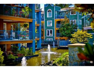 """Photo 1: 305 1199 WESTWOOD Street in Coquitlam: North Coquitlam Condo for sale in """"THE CRESCENT"""" : MLS®# V1052565"""