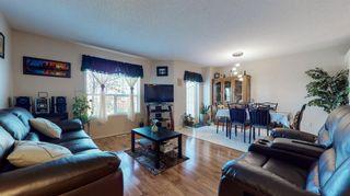 Photo 5: 213 Taracove Place NE in Calgary: Taradale Row/Townhouse for sale : MLS®# A1117332