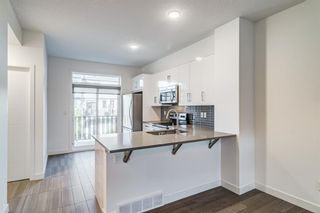 Photo 11: 26 Walden Path SE in Calgary: Walden Row/Townhouse for sale : MLS®# A1150534