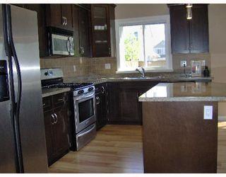 """Photo 2: 1094 EUPHRATES Crescent in Port_Coquitlam: Riverwood House for sale in """"RIVERWOOD"""" (Port Coquitlam)  : MLS®# V650838"""
